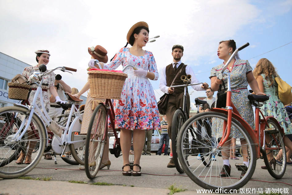 Dressed in vintage clothes participants in St
