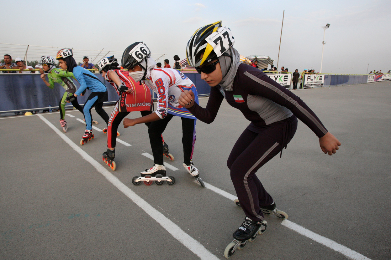Iranian rollerbladers wait to hear whistle of referee, to start their competition, in a women's rollerblading championship league, at the Azadi (Freedom) sport complex, in Tehran, on June 30, 2011. (AP Photo/Vahid Salemi) #