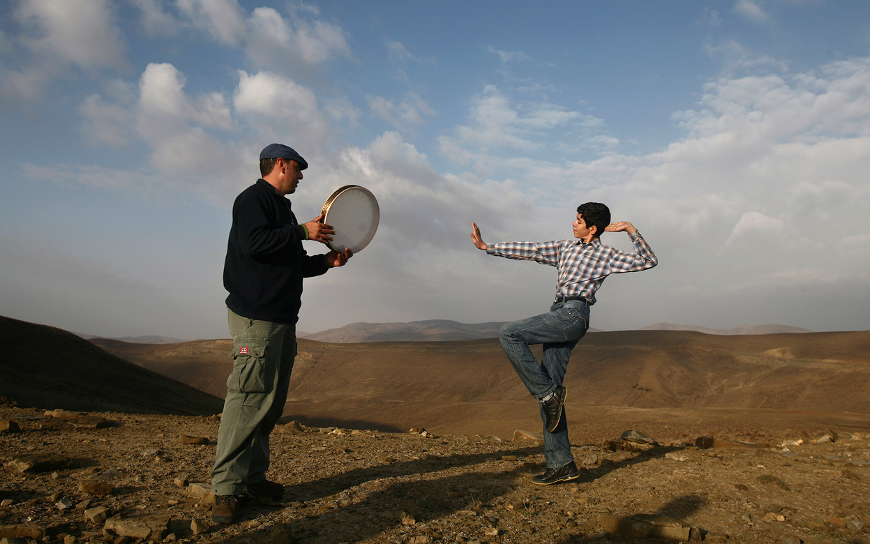 min Gholami, right, dances in Azeri-style as Aydin Kanani plays a Gaval, a large tambourine, in the Gharadagh mountainous area in northwestern, Iran, on October 26, 2011. In the 1980s, Iran's music almost vanished. Music schools went into full recession, police or militias stopped cars to check what passengers were listening to and broke tapes playing pre-revolutionary singers, and clerical institutions even banned music as un-Islamic. But Iran's social life has dramatically changed a decade later, with a landslide victory of former President Mohammad Khatami relaxing some of rigid restrictions on cultural and social activities, including bans on music bands, but Iran has recently tightened censorship of books, films, and music since President Mahmoud Ahmadinejad came to power. (AP Photo) #